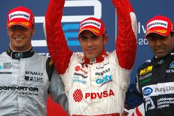 Pastor Maldonado celebrates his victory on the podium with Andreas Zuber and Karun Chandhok