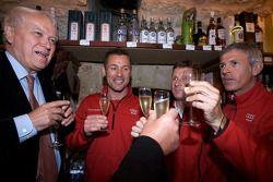 Hand imprint ceremony: 2008 winners Tom Kristensen, Allan McNish and Rinaldo Capello toast with cham