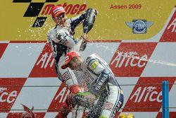 Podium: race winner Valentino Rossi, Fiat Yamaha Team celebrates 100th MotoGP win with Jorge Lorenzo