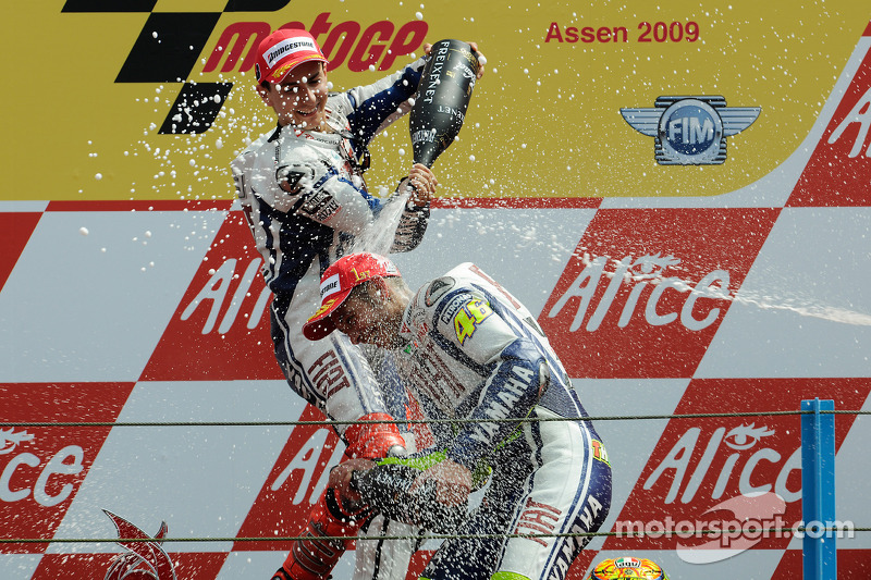 Podium: race winner Valentino Rossi, Fiat Yamaha Team celebrates 100th MotoGP win with Jorge Lorenzo