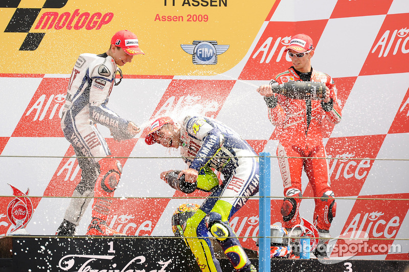 Podium: race winner Valentino Rossi, Fiat Yamaha Team, second place Jorge Lorenzo, Fiat Yamaha Team,
