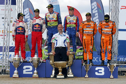Podium: winners Mikko Hirvonen and Jarmo Lehtinen, second place Daniel Sordo and Marc Marti, third p