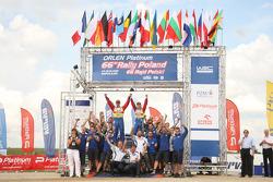 Podium: winners Mikko Hirvonen and Jarmo Lehtinen celebrate