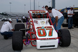 Checking Jacob Wilson's tires while Wilson confers with the crew
