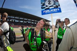 Motorsport.com's Eric Gilbert playing grid boy for the #1 Manthey Racing Porsche 911 GT3 RSR