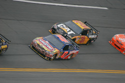 Marcos Ambrose, JTG Daugherty Racing Toyota and Jeff Burton, Richard Childress Racing Chevrolet