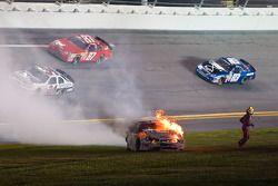 Kertus Davis runs away from his burning race car
