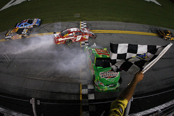 Kyle Busch, Joe Gibbs Racing Toyota and Kasey Kahne, Richard Petty Motorsports Dodge cross the finish line after their crash