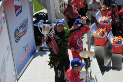 Podium: race winner Justin Wilson, Dale Coyne Racing, second place Ryan Briscoe, Team Penske, third