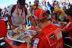 Casey Stoner, Ducati Marlboro Team signs autographs in the fan area
