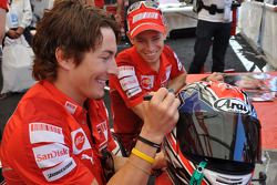 Nicky Hayden, Ducati Marlboro Team and Casey Stoner, Ducati Marlboro Team sign autographs in the fan area