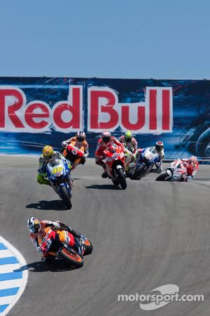 Dani Pedrosa, Repsol Honda Team leads Valentino Rossi, Fiat Yamaha Team and the rest of the field