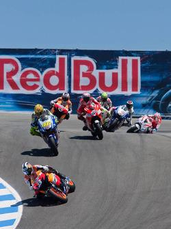 Dani Pedrosa, Repsol Honda Team leads Valentino Rossi, Fiat Yamaha Team and the rest of the field