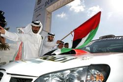 FIA's Vice-President for sport and 14-time Middle East Rally Champion Mohamed Ben Sulayem gives the start flag for Dubai International Rally