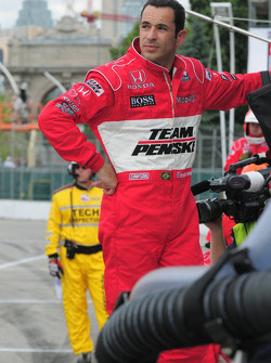 Helio Castroneves on the pitwall after his retirement