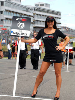 The grid girl for Henri Karjalainen