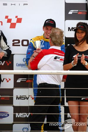 Jonathan Palmer, CEO Motorsport Vision, hands the third place trophy to Henry Surtees