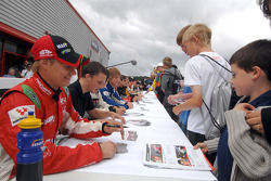 Sebastian Hohenthal signs an autograph for a young fan