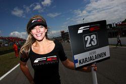 The grid girl for Henri Karjalainen