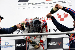 Race 2 winner Andy Soucek is sprayed with champagne on the podium