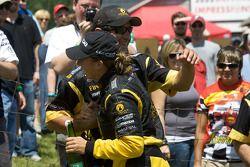 Race winner Simona De Silvestro, Team Stargate Worlds celeberates with a team member