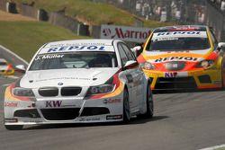 Jorg Muller leads Tiago Monteiro
