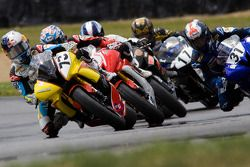 Jay Beach leads a group of Supersport riders