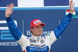 Giedo Van der Garde celebrates his victory on the podium