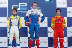 Giedo Van der Garde celebrates his victory on the podium with Luca Filippi and Lucas Di Grassi