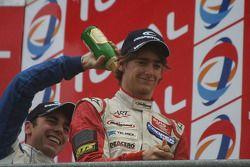 Gabriel Dias pours champagne over Esteban Gutierrez