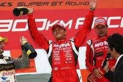 GT500 podium: class and overall winner Satoshi Motoyama