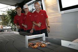 Mattias Ekström, Oliver Jarvis and Alexandre Prémat play with slot cars