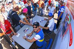 Bruno Senna and Tiago Monteiro sign autographs
