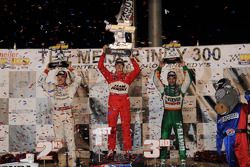 Ryan Briscoe, Team Penske on the podium with Ed Carpenter, Vision Racing and Tony Kanaan, Andretti Green Racing
