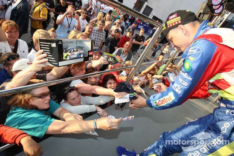 Mikko Hirvonen signs as many autographs as he can