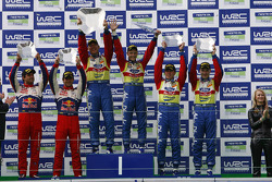Podium: winners Mikko Hirvonen and Jarmo Lehtinen, second place Sébastien Loeb and Daniel Elena, thi