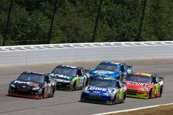 Denny Hamlin, Joe Gibbs Racing Toyota and Jimmie Johnson, Hendrick Motorsports Chevrolet battle for