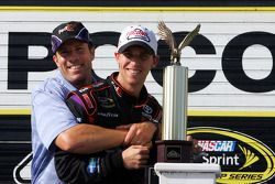 Victory lane: race winner Denny Hamlin, Joe Gibbs Racing Toyota, celebrates with J.D. Gibbs