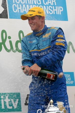 James Nash sprays champagne
