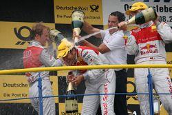 Race winner Timo Scheider, Audi Sport Team Abt Audi A4 DTM gets a champagne shower