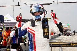 Pole winner Gil de Ferran celebrates