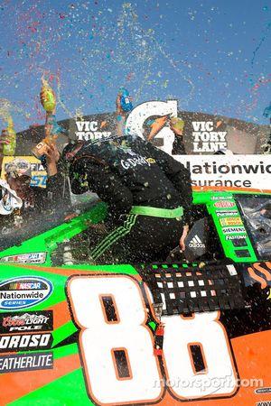 Victory lane: race winner Brad Keselowski celebrates