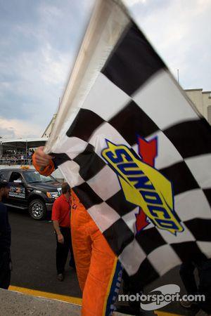 Race winner Andrew Ranger arrives at the podium ceremony