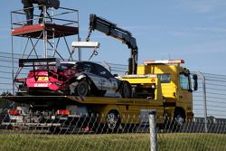 The damaged car of Katherine Legge, Audi Sport Team Abt Audi A4 DTM being hauled back to the paddock