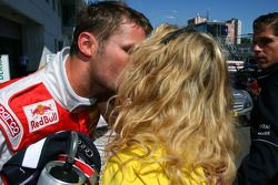 Pole sitter Martin Tomczyk, Audi Sport Team Abt, getting a kiss from his girlfriend Christina Surer