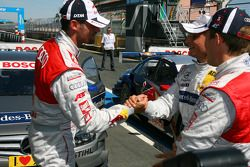 Bruno Spengler, Team HWA AMG Mercedes, congratulates Martin Tomczyk, Audi Sport Team Abtwith his pole position