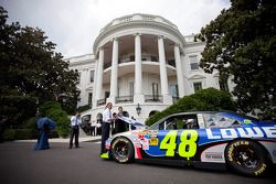 President Barack Obama looks under the hood of the No. 48 Lowe's Chevrolet with three-time defending NASCAR Sprint Cup Series champion Jimmie Johnson at the White House in Washington, D.C. on Wednesday.