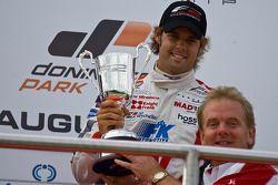 Jonathan Palmer presents race winner Andy Soucek with the winners trophy