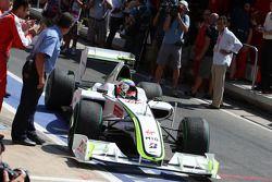 Race winner Rubens Barrichello, BrawnGP arrives in parc fermé