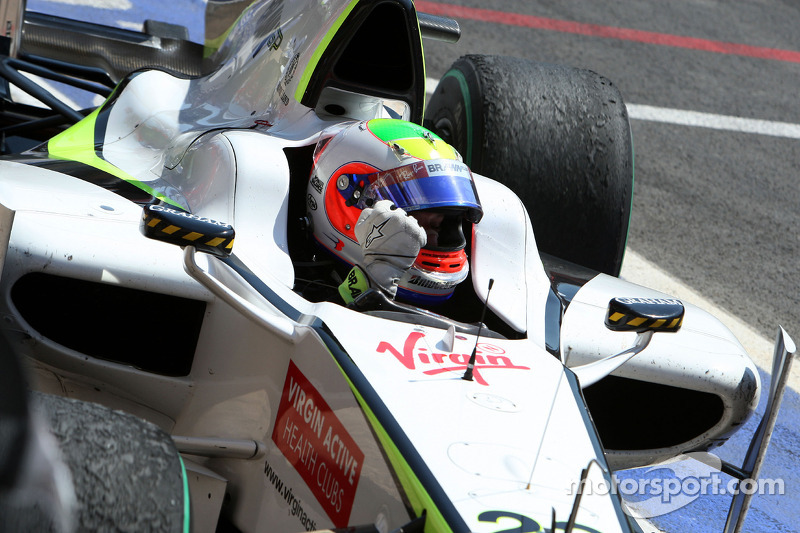 Race winner Rubens Barrichello, BrawnGP arrives in parc fermé
